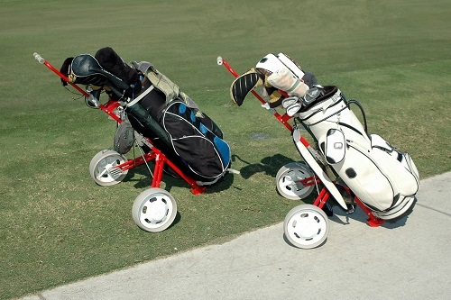 Two Golf Bags on Push Carts