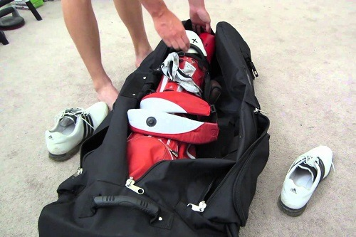 Putting Golf Gear in CaddyDaddy Golf Co-Pilot Pro 2 Hybrid Travel Bag